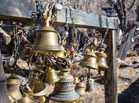 yoke: The ritual bell in a Buddhist temple in the mountains of Nepal