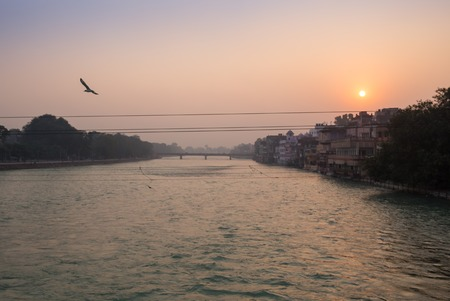 boatman: A view of  holy ghats of Varanasi with a boatman sailing