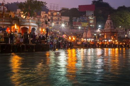 benares: A view of  holy ghats of Varanasi with a boatman sailing