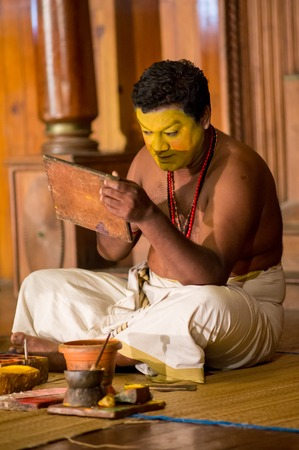 kathakali: FORT COCHIN, India -  January 10, 2015: Kathakali performer in the virtuous pachcha green role in Cochin on January 10, 2015 in South India. Kathakali is the ancient classical dance form of Kerala.