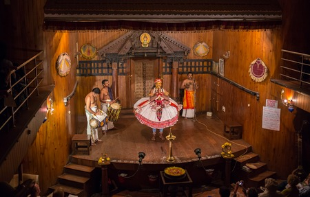 FORT COCHIN, India -  January 10, 2015: Kathakali performer in the virtuous pachcha green role in Cochin on January 10, 2015 in South India. Kathakali is the ancient classical dance form of Kerala.