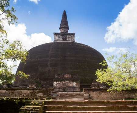 vihara: The rear of the Rankoth Vehera, the largest Buddhist stupa at the ruins of the ancient kingdom capitol of Polonnaruwa, Sri Lanka Stock Photo