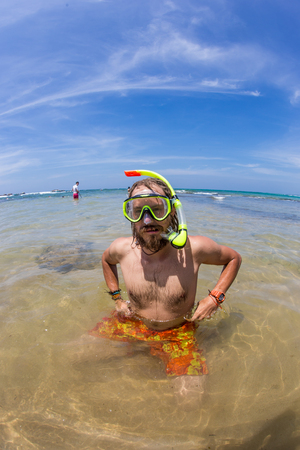 funny picture: Happy diving man in a swimming mask and snorkel. Funny  picture.