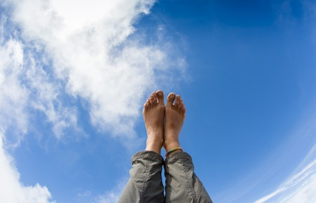 Feeling relaxed and letting the bare feet air out in the sun. Stock Photo