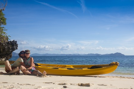 caribe: Couple canoeing in lagoon of West French indies Stock Photo