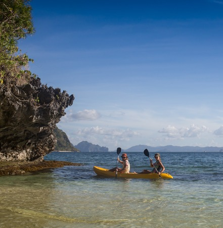 indies: Couple canoeing in lagoon of West French indies Stock Photo
