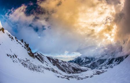 Winter mountains during a beautiful sunset. Kazakstan Tuyuk-su