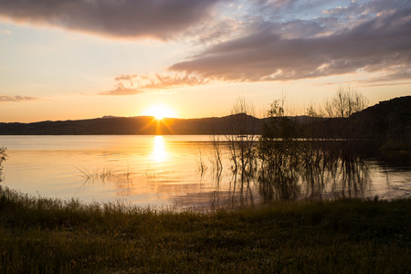 sunset lake: Nice landscape with sunset on lake Barabay