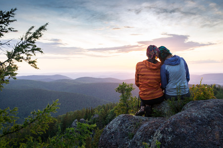 adventure sports: Couple Watching Sunset Mountain Outdoors Concept in Russia