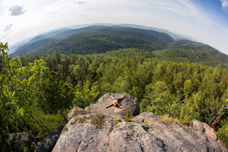 man meditating: man meditating on a rock in the mountain of Russia Stock Photo