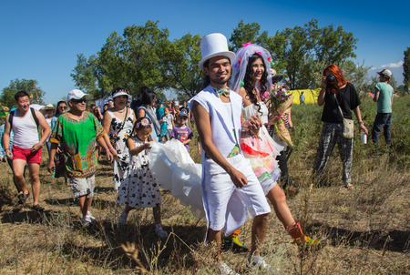 Cosmos Village, Almaty Province, Kazakhstan - 16 August 2015: The festival of ethnic music Forey, a lot of people gathers on this holiday to relax and have  fun. Ethnic open-air concert, where many people gathered.  Moment in wedding,  bride and bridegroo