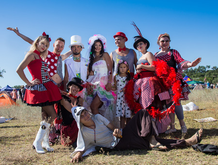 festival moment: Cosmos Village, Almaty Province, Kazakhstan - 16 August 2015: The festival of ethnic music Forey, a lot of people gathers on this holiday to relax and have  fun. Ethnic open-air concert, where many people gathered.  Moment in wedding,  bride and bridegroo