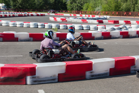 kart: Indoor karting race rushing kart and safety barriers Stock Photo
