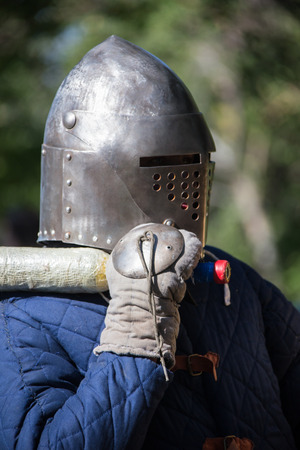 hauberk: Glistening Knight holding handed sword in the forest Stock Photo