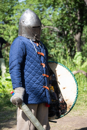 glistening: Glistening Knight holding handed sword in the forest Stock Photo