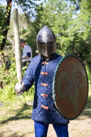 handed: Glistening Knight holding handed sword in the forest Stock Photo