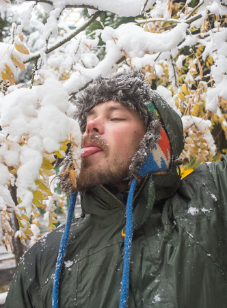 wintery: Wintery scene of shivering man in snowstorm or ice storm Stock Photo