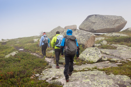 arms wide open: Hiker on Trolltunga with arms wide  open
