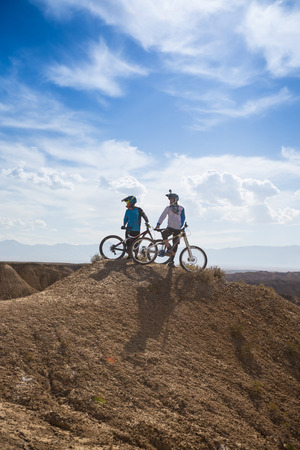 Young man on a mountain bike riding and relaxing in Charyn canyon,  Kazakhstan Stock Photo