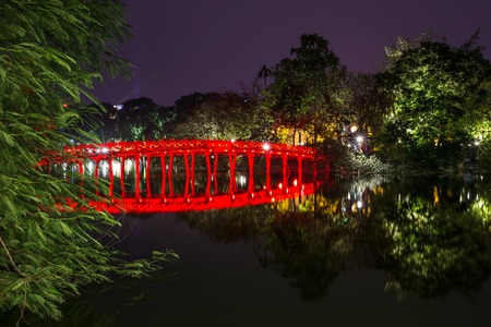 returned: Hoan Kiem Lake - Lake of the Returned Sword and the Turtle Tower among laser lighting show at blue hour. Blue light rays display at historic center of Hanoi, Vietnam. The tower reflected in the lake