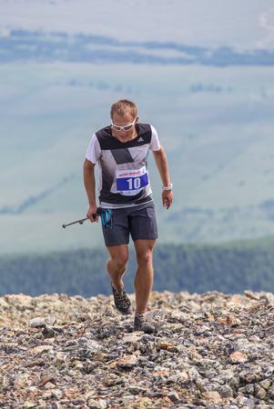 aktru: AKTRU,KURDAI,GORNII ALTAI  KAZAKHSTAN - JUNE 10: International Championship in the discipline skyrunning Aktru 2016. Athletes from different countries compete in the championship in a very beautiful mountains of Altai. A strong man runs up to the title