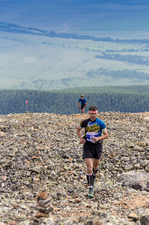 rival rivals rivalry season: AKTRU,KURDAI,GORNII ALTAI  KAZAKHSTAN - JUNE 10: International Championship in the discipline skyrunning Aktru 2016. Athletes from different countries compete in the championship in a very beautiful mountains of Altai. A strong man runs up to the title