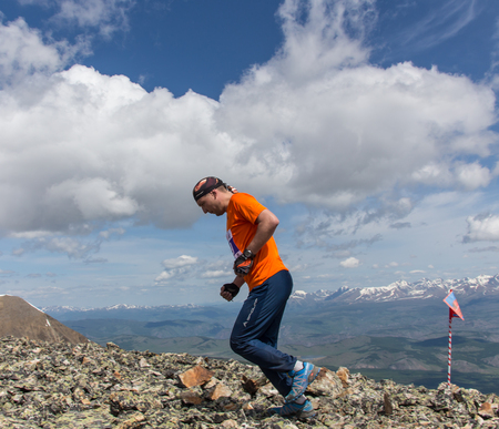 rivals rival rivalry season: AKTRU,KURDAI,GORNII ALTAI  KAZAKHSTAN - JUNE 10: International Championship in the discipline skyrunning Aktru 2016. Athletes from different countries compete in the championship in a very beautiful mountains of Altai. A strong man runs up to the title