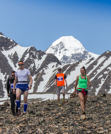 rival rivals rivalry season: AKTRU,KURDAI,GORNII ALTAI  KAZAKHSTAN - JUNE 10: International Championship in the discipline skyrunning Aktru 2016. Athletes from different countries compete in the championship in a very beautiful mountains of Altai. A group of people comes to a poin