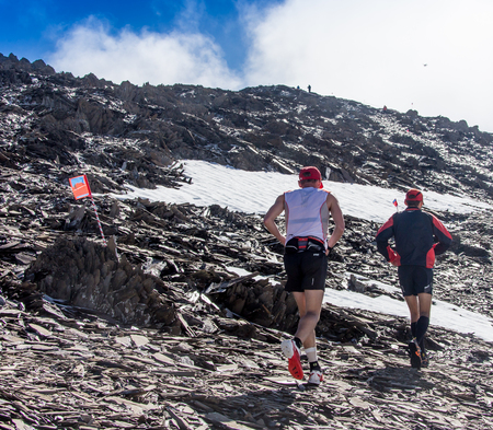 AKTRU,KURDAI,GORNII ALTAI  KAZAKHSTAN - JUNE 10: International Championship in the discipline skyrunning Aktru 2016. Athletes from different countries compete in the championship in a very beautiful mountains of Altai. A strong man runs up to the title