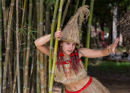 latina america: Girl wearing Africa clothes for the African Party near Huts