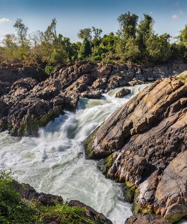turbulent strong river waterfull in the Laos