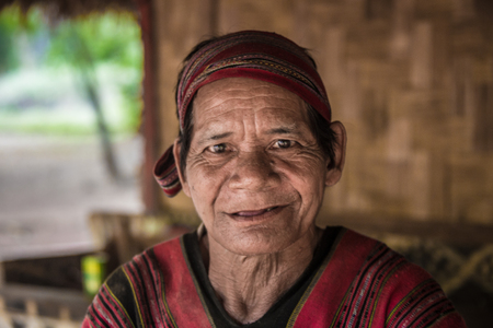 CHIANG RAI  THAILAND - FEBRUARY 10 2016: Visit ethnic village, near the town of Chiang Rai where the locals live by historical laws, wearing national clothes and engaged in their craft.