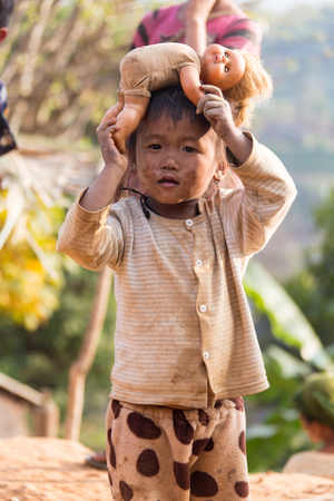 vietnamese ethnicity: KOLTI VILLAGE  WESTERN NEPAL- FEBRUARY 10 2016 - group of nepalese children near Kolti village in western Nepal