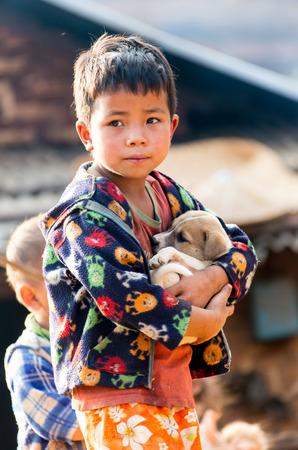 KOLTI VILLAGE / WESTERN NEPAL- FEBRUARY 10 2016 - group of nepalese children near Kolti village in western Nepal