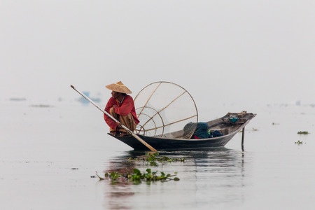 INLE LAKE/MYANMAR-FEBRUARY 10 2016: Silhouette of fisherman at sunset Inle Lake Burma Myanmar Editorial