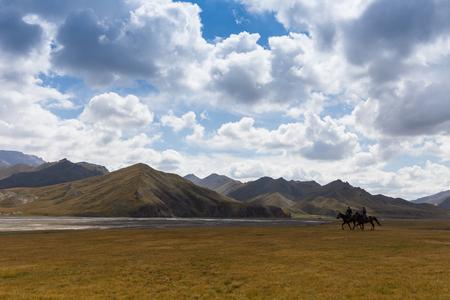 mongolia horse: BAYAN-ULGII, MONGOLIA - APREL 10: Unidentified young boy ride a horse around of village Sagsai of Western Mongolia on Aprel 10, 2016 in Bayan-Ulgii, Mongolia