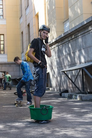 KAZAKHSTAN ALMATY - AUGUST 28, 2016: Urban extreme competition, where the city athletes compete in the disciplines: skateboard, roller skates, BMX. Bmx stunt performed at the top of a mini ramp on a skatepark.Skateboarding Practice Freestyle Extreme Sport Editorial