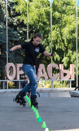 KAZAKHSTAN ALMATY - AUGUST 28, 2016: Urban extreme competition, where the city athletes compete in the disciplines: skateboard, roller skates, BMX. Bmx stunt performed at the top of a mini ramp on a skatepark.Get Away from the Office! - wide-angle shot, l Editorial
