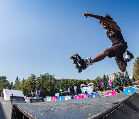 wideangle: KAZAKHSTAN ALMATY - AUGUST 28, 2016: Urban extreme competition, where the city athletes compete in the disciplines: skateboard, roller skates, BMX. Bmx stunt performed at the top of a mini ramp on a skatepark.Get Away from the Office! - wide-angle shot, l Editorial