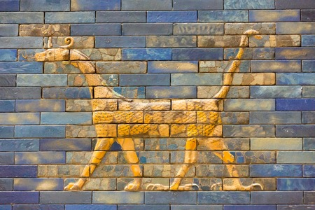 ishtar: Tiles Pattern of Babylons The Ishtar Gate inside The Pergamon Museum (Pergamonmuseum), Berlin, Germany - 6 Feb 2016: The museum is visited by approximately 1,135,000 people every year.