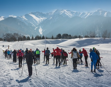 ALMATY, KAZAKHSTAN - FEBRUARY 18, 2017: amateur competitions in the discipline of cross-country skiing, under the name of ARBA Ski Fest. A large number of people start simultaneously.