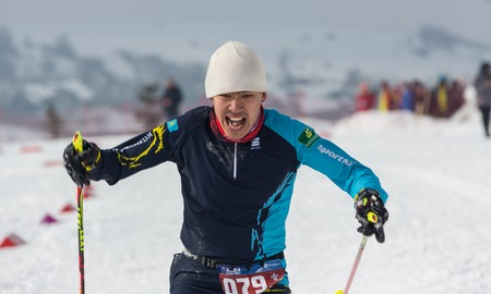 ALMATY, KAZAKHSTAN - FEBRUARY 18, 2017: amateur competitions in the discipline of cross-country skiing, under the name of ARBA Ski Fest. A man cross-country skiing on the trail in Almaty mount Editorial