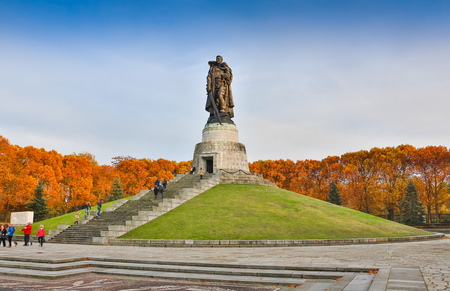 BERLIN, GERMANY - OCTOBER 02, 2016: Monument to Soviet soldier holding at the hands German child at Soviet War Memorial in Treptower Park.