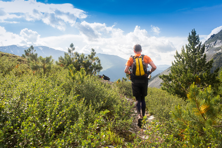 Man trail running in the mountain in Altai, Russia Stock Photo