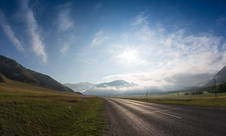 Road in sunrise time, Ailai mountains, Russia Reklamní fotografie