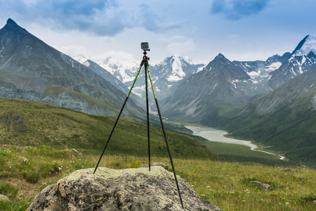 tripod mounted: Photo camera mounted on tripod outdoors, Altai, Russia