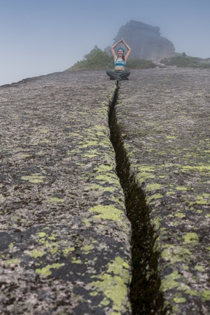 Woman standing on solid rock to avoid earthquake
