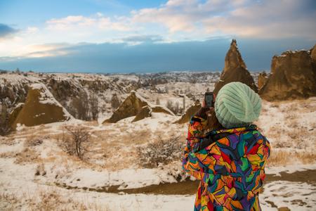 Girl looking at balloons in Cappadocia