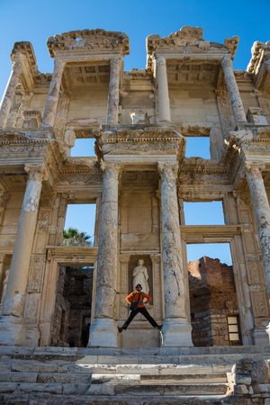 a tourist man is taking Ephesus Celsus Librarys photo in a rainy day Stock Photo