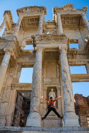 a tourist man is taking Ephesus Celsus Librarys photo